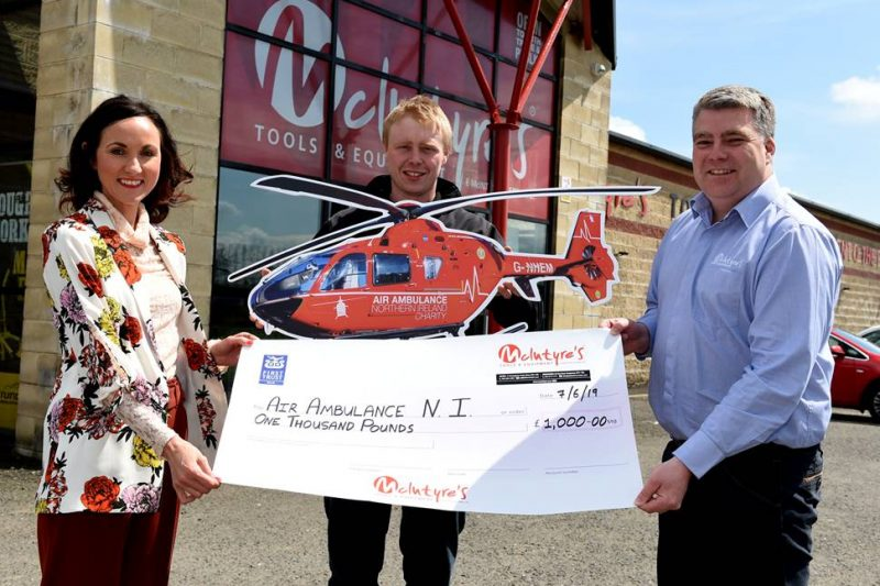 McIntyres Tools & Equipment NI's Nigel Gibson and Christopher Ramsey with Kerry Anderson from Air Ambulance NI